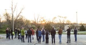 Team members watch as day breaks in the east.